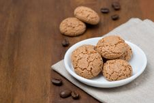 Free Biscotti Cookies And Coffee Beans On A Wooden Table Royalty Free Stock Photo - 36603025