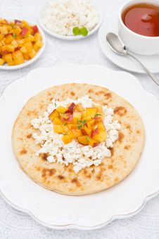 Flat Bread With Cottage Cheese With Honey, Nuts, Peaches Stock Image