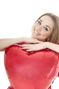 Smiling Woman Holding Red Heart Balloon Royalty Free Stock Images