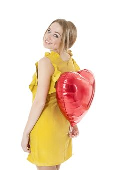 Woman Holding Red Heart Balloon. Stock Image