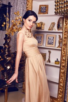Beautiful Girl In Beige Dress Royalty Free Stock Images