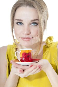 Woman Offering A Cup Of Coffee On A Plate Royalty Free Stock Photography