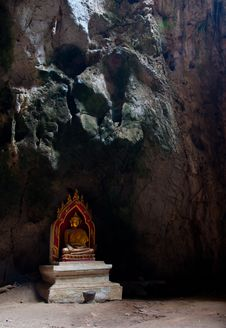 A Sitting Golden Buddha In The Cave In Thailand Royalty Free Stock Photography