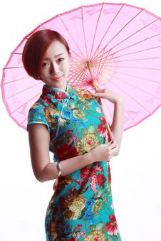 Free Chinese Girl Wearing A Cheongsam. Stock Images - 36641124