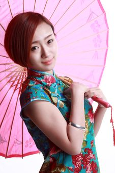 Free Chinese Girl Wearing A Cheongsam. Stock Photography - 36641172