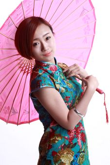 Chinese Girl Wearing A Cheongsam. Royalty Free Stock Photography