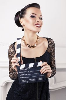 Free Portrait Of Beautiful Girl With Cinema Clapperboard Royalty Free Stock Photo - 36641825