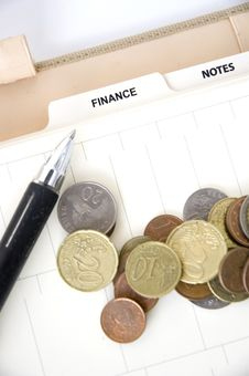 Free Euro Coins With Pen On Finance Page Stock Image - 36650861