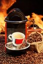 Free Capsule Coffee Machine With  Espresso Cup Near Fireplace Royalty Free Stock Photography - 36665967