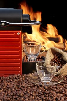Free Capsule Coffee Machine With Two Espresso Cups Near Fireplace Royalty Free Stock Photo - 36661205