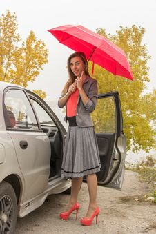 Free Happy Woman Outdoor With An Umbrella Royalty Free Stock Image - 36663306