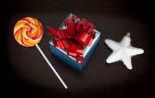 Free Blue Gift Box, Candycane And White Christmas Star On Black Royalty Free Stock Image - 36670786
