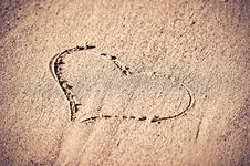 Free Concept Of Love.  Heart In The Sand Stock Photography - 36679042