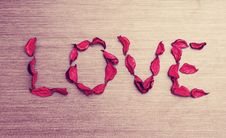 Free Background Valentine S Day. Word Love Petals Of Red Roses On A W Stock Image - 36679101