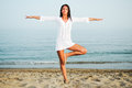 Free Pretty Woman Doing Yoga On The Beach Royalty Free Stock Image - 36687716
