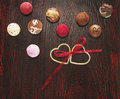 Free Colorful Pralines Candies With Two Hearts And Ribbon Wooden Floor Royalty Free Stock Images - 36688099