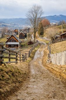 Free Dirty Road In Carpathian Village Stock Image - 36683241