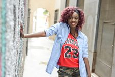 Free Beautiful Black Woman In Urban Background With Red Hair Royalty Free Stock Photos - 36687568