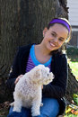 Free Young Girl And Poodle By Tree Royalty Free Stock Image - 3676886