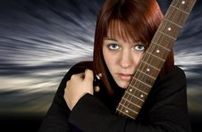 Free Sad Girl Protecting Her Guitar Stock Photo - 3672430