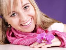 Smiling Woman With Orchid Royalty Free Stock Images