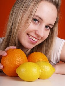 Free Girl With Oranges And Lemons Royalty Free Stock Image - 3676436