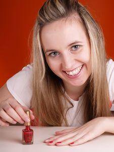 Free Woman Applying Red Nail Polish Royalty Free Stock Photography - 3676537