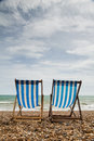 Free Two Deck Chairs On Brighton Beach, England Royalty Free Stock Photography - 36705727