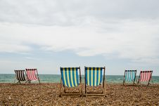 Free Deck Chairs On Brighton Beach, England Stock Images - 36705694
