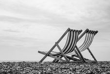 Free Black And White Deck Chairs On Brighton Beach, England Stock Image - 36705741