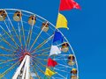 Free Ferris Wheel And Colorful Flags Royalty Free Stock Image - 36716416