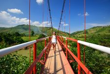 Free Traveler Passes The River On A Suspension Bridge. Vietnam Royalty Free Stock Image - 36713926