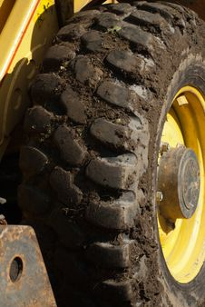 Free Muddy Digger Wheel With Yellow Trim Royalty Free Stock Photos - 36717268