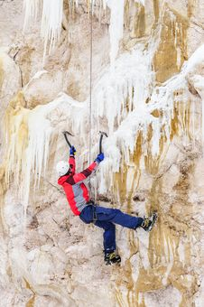 Young Man Climbing The Ice Stock Photography