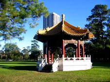 Pagoda And High-Rise Building Behind Stock Photo