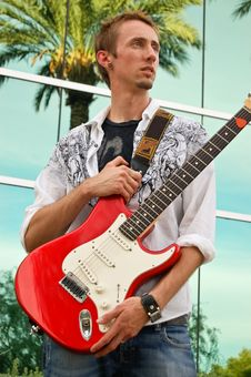 Free Man Holding Red Guitar Stock Photography - 3686132