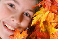 Free Young Boy Headshot In Autumn Leaves Royalty Free Stock Photography - 3692997