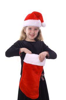 Free Child With Santa Hat & Stocking Royalty Free Stock Photo - 3692155