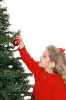 Child Hanging Ornament On Tree Vertical Stock Photos