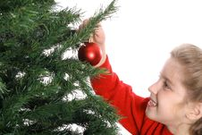 Child Hanging Ornament On Tree Royalty Free Stock Photography