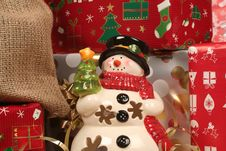 Snowman And Gifts, Wraps Royalty Free Stock Photography