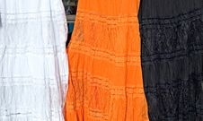 Free 3 Coloured Dresses For Sale At A Spanish Market Royalty Free Stock Photo - 374115