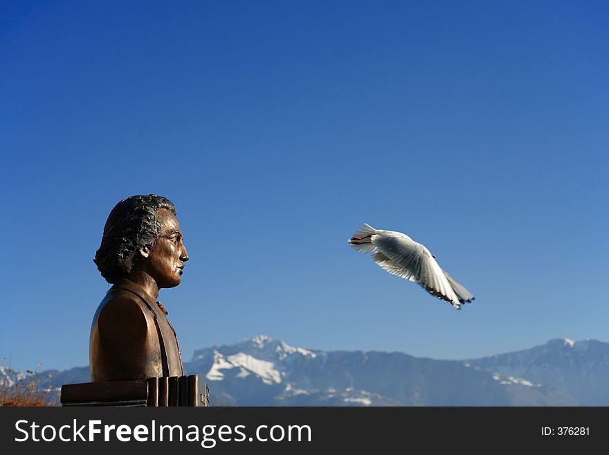 Statue looks the bird