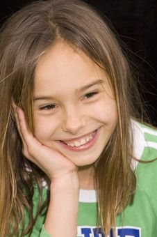 Free Cute Girl Smiling And Resting Head In Hand Stock Photography - 3701102