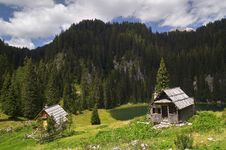Apline Huts By The Lake. Stock Images