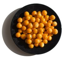 Free Fresh Cape Gooseberries On A Black Plate 1 Royalty Free Stock Image - 3702726