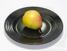 Free Fresh Pear On A Black Plate Stock Images - 3702764