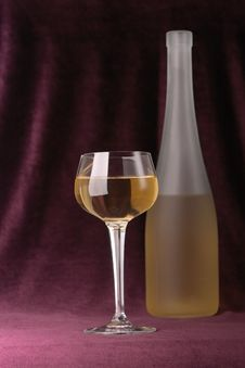 Glass And Bottle Of White Wine Royalty Free Stock Image