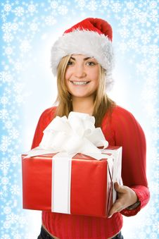 Christmas Girl In Red Hat With Box Gift Stock Image