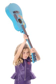 Rockstar Child Smashing Her Guitar Stock Photo